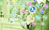 Businessman pressing social icon — 图库照片