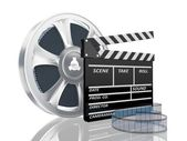 Cinema clap and film reel — Stock Photo