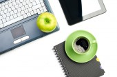 Green apple on worplace — Stock Photo