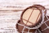 Dark chocolate on wooden background — Stock Photo
