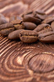 Coffee beans on wood background — Stock Photo