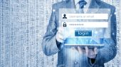 Businessman typing login and password — Stockfoto