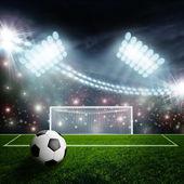 Voetbal op groene stadion arena — Stockfoto
