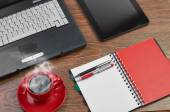 Laptop and office supplies on wooden table — Stock Photo