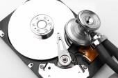 Stethoscope on the hard disk drive over white — Stock Photo