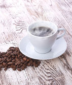 Coffee cup with space on the wooden table — Stock Photo