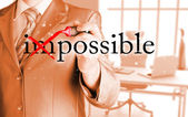 Businessman Hand turning the word Impossible into Possible with red marker — Foto de Stock