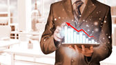 Businessman working with financial data — Stock Photo