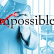 Businessman turning Impossible into Possible — Stock Photo #63888159
