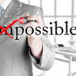 Businessman turning Impossible into Possible — Stock Photo #63888193