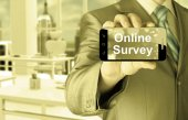 Businessman showing business concept on smartphone  - Online Survey — Stock Photo
