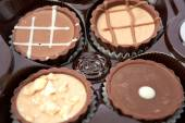 Dark chocolate on a white background — Stock Photo