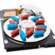 Pills on computer hard drive - concept technology background — Stock Photo #65057295