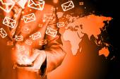 Business man holding smart phone and sending emails — Stok fotoğraf