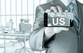Business man hand holding smartphone — Stock Photo