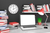 Workspace with laptop and books — Stock Photo