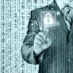 Businessman selecting padlock — Stock Photo #66989263