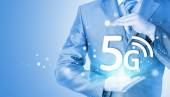 Businessman holding in hand 5G, technology background — Stockfoto