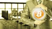 Businessman with protective gesture bitcoins — Stok fotoğraf