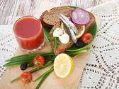Sardines on slice bread — Stock Photo
