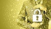 Businessman holding security lock — Stock Photo