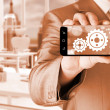 Businessman shows gears on smartphone — Stock Photo #66990231