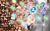 Businessman pressing social icon — Stock Photo