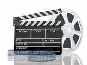 Cinema clap and film reel — Stock Photo
