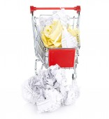 Crumpled paper and shopping cart — Stock Photo