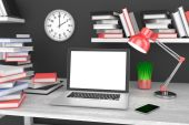 Workspace with laptop and books — Foto Stock