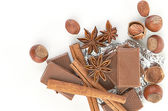 Chocolate,nuts and spice — Stock Photo