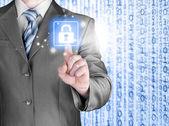 Businessman selecting padlock — Stockfoto