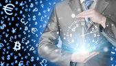Businessman holding clock — Stock fotografie