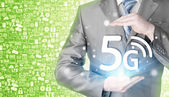 Businessman holding in hands 5G — Stock Photo