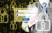 Businessman typing login and password — Stock Photo