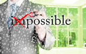 Businessman turning Impossible into Possible — Stock Photo