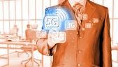 Businessman pushing 5G — Foto de Stock