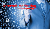 Businessman writing internet marketing — Stok fotoğraf