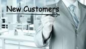 Businessman writing new customers — Stock Photo