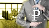 Businessman protecting ruble — Stock Photo
