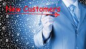 Бизнесмен написания новых клиентов — Стоковое фото