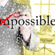 Businessman turning Impossible into Possible — Stock Photo #80422394