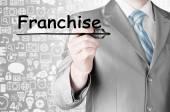 Man writing franchise — Stock Photo
