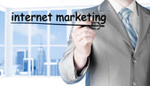 Businessman writing internet marketing — Stock Photo