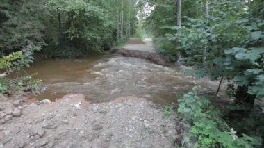 River flood broken road after heavy rainfall — Stock Video