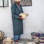 Постер, плакат: Elder street vendor selling handmade souvenirs