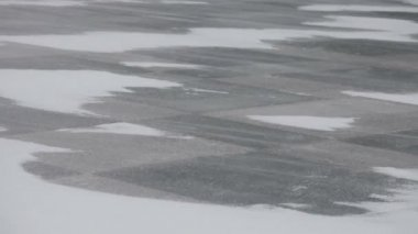 Snow blowing and drifting across a  stone tiles — Stockvideo