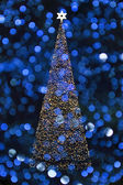 Christmas tree with blue background — Stock Photo