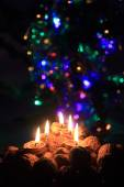 Candle from the walnut shells - christmas tradition — Stock Photo