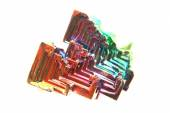 Color bismuth crystal isolated  — Стоковое фото